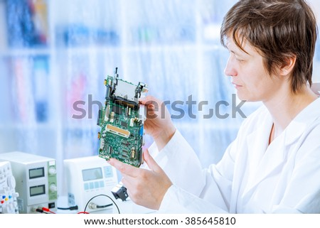 Woman repair electronics device