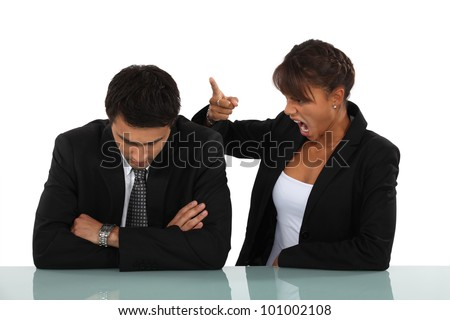 Woman reprimanding her employee - stock photo