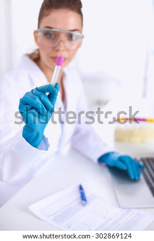 Woman researcher is surrounded by medical vials and flasks, isolated on white