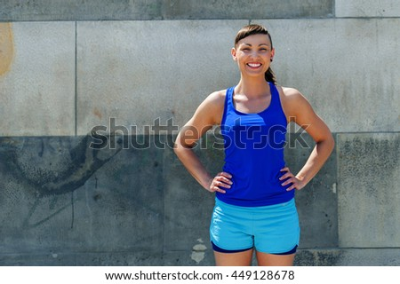 Woman resting after jogging. Smiling.