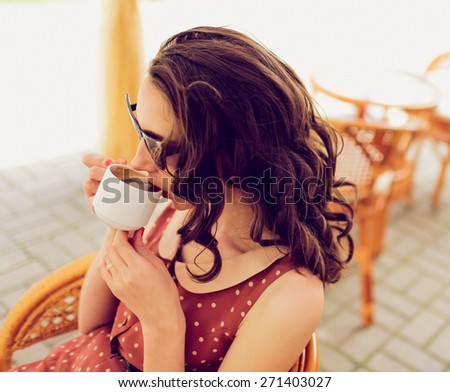 Woman resting and drinking coffee