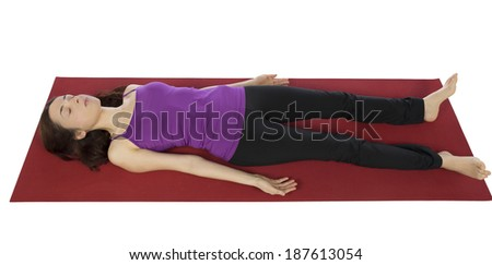 Woman resting in Shavasana during Yoga. - stock photo
