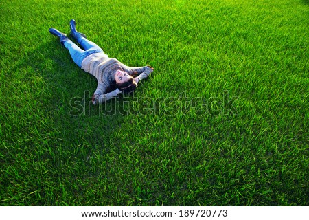 Woman resting on green grass