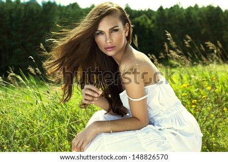 Woman resting on meadow - stock photo