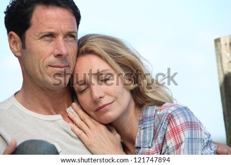 Woman resting on the shoulder of a man