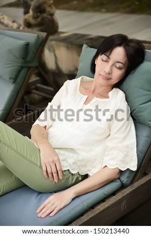 Woman resting, relaxation outdoors, pleasure concept