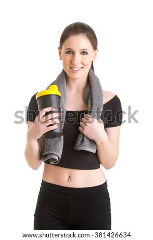 Woman resting with a towel around her neck after a fitness workout, isolated in white - stock photo