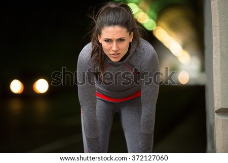 Woman rests catches her breath after intense exercise routine independent city - stock photo