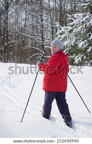 Woman retirement age, europeans, skiing in the woods. February