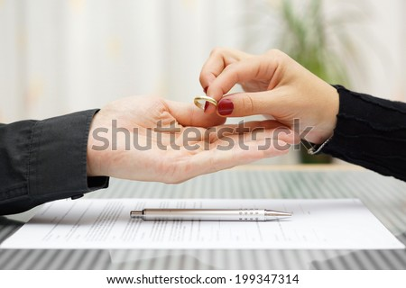woman returned wedding ring to  husband . Divorce concept - stock photo
