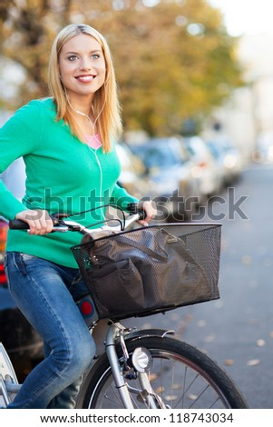 Woman riding a bike in the city - stock photo