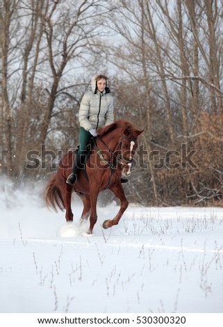Woman riding in snow in cold winter day