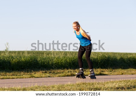 Woman rollerblading in summer evening - stock photo