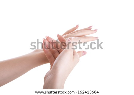 Woman rubs cream hands, close-up. Isolated objects.