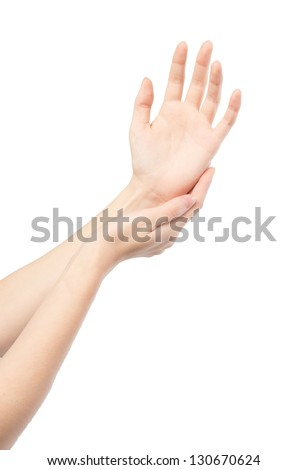 Woman rubs hand cream, makes a hand massage
