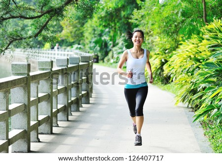 woman runner at park trail