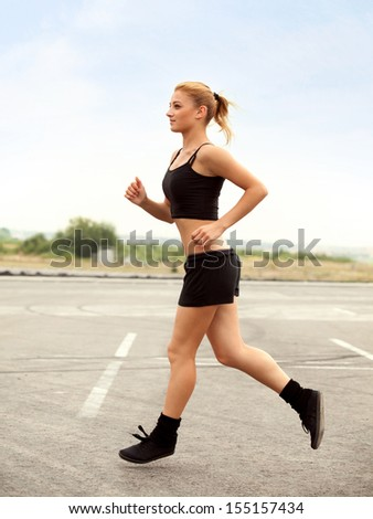 Woman Runner. Fitness Girl Running outdoors. jogger
