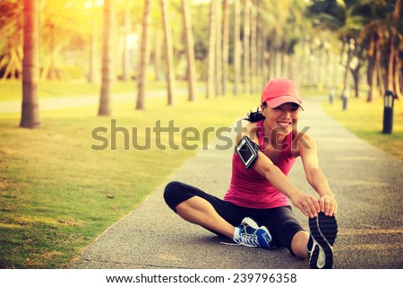woman runner stretching legs outdoor  - stock photo