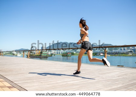 Woman running at Hong Kong city