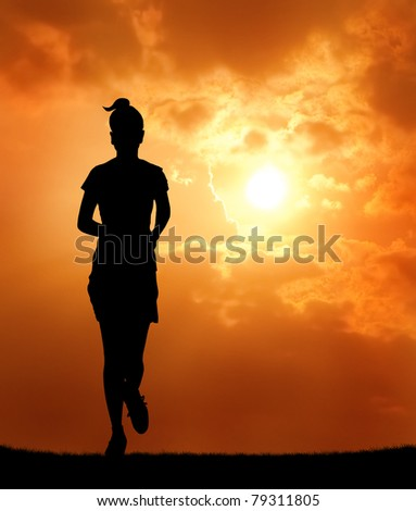 woman running at sunset silhouetted - stock photo
