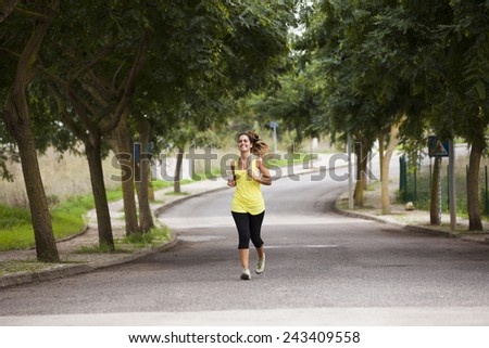 Woman running at the street - stock photo