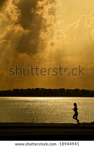Woman running by lake