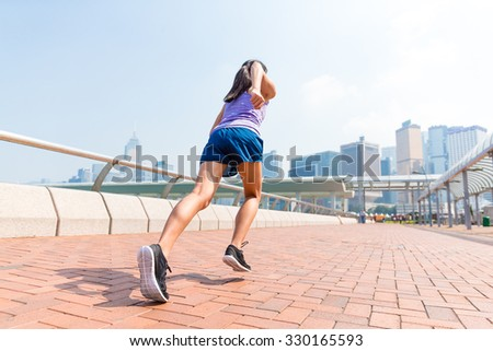 Woman running in a city at Hong Kong