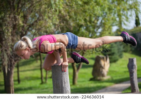 Woman running in autumn fall forest. Female runner training outdoor in profile. Healthy lifestyle image of young woman jogging outside - stock photo