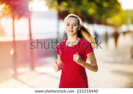 Woman running in city  - stock photo