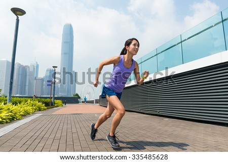 Woman running in Hong Kong city - stock photo