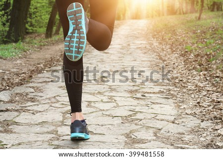 Woman running in nature. Sport, jogging, healthy life style concept - stock photo