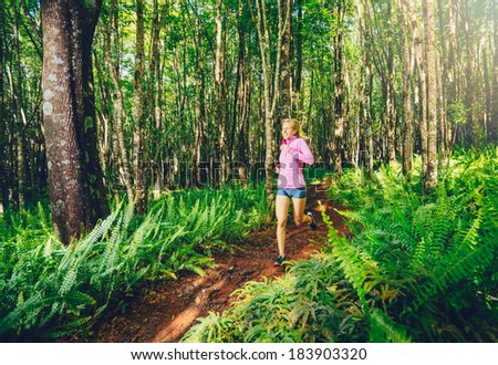 Woman Running in Nature. Trail Running in Forest. Active Healthy Lifestyle Fitness Concept.