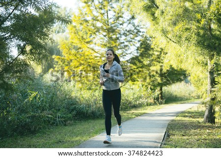 Woman running in park to keep herself in shape
