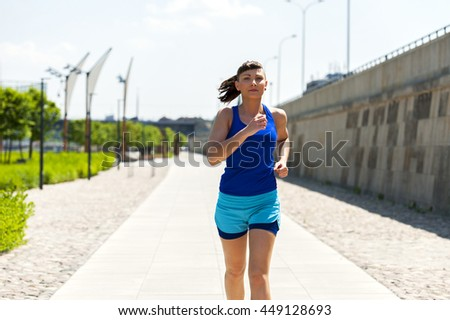 Woman running in the city park.