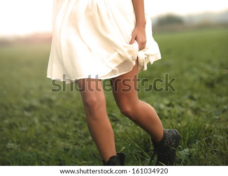 Woman running in the field - stock photo