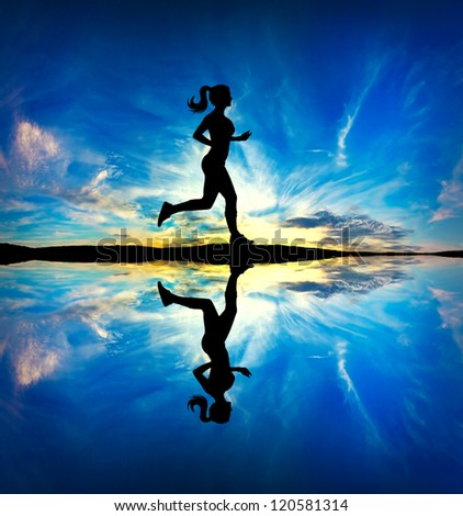 Woman running in the morning - stock photo