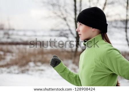 Woman running in winter - stock photo