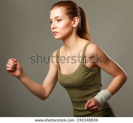 woman running isolated on grey background