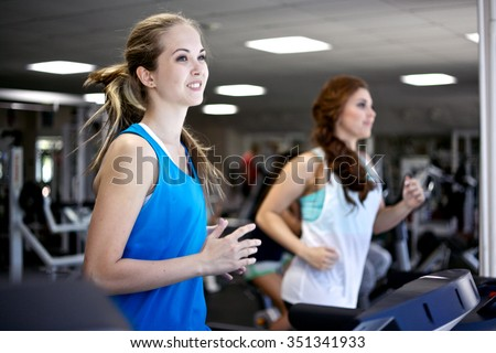 Woman running on a treadmill/Running on a Treadmill