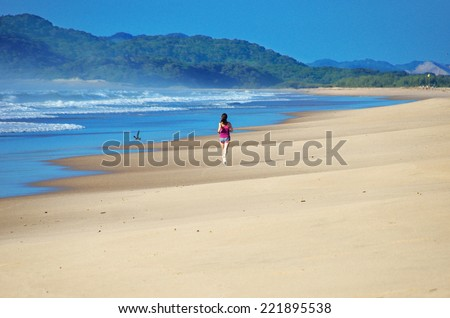 Woman running on beach, beautiful girl runner jogging outdoors, training for marathon, exercising and fitness concept  - stock photo