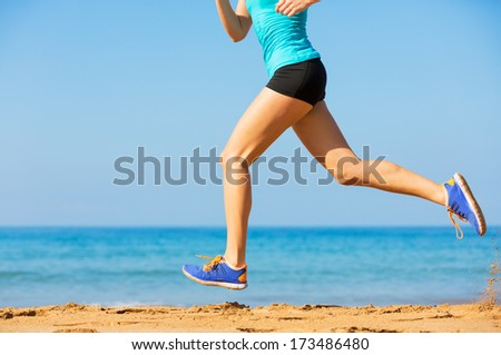 Woman running on beach, Exercise fitness concept - stock photo