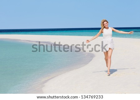 Woman Running On Beautiful Tropical Beach