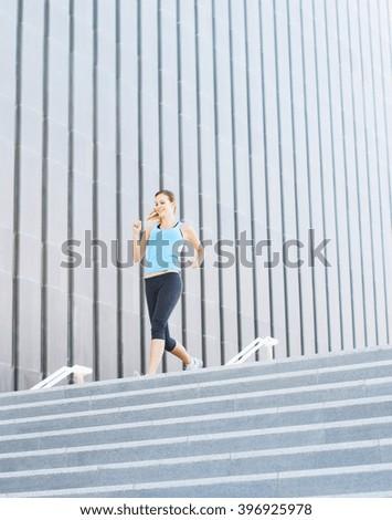 woman running on city  - stock photo