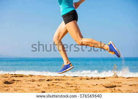 Woman running on the beach, fitness and heath care concept - stock photo