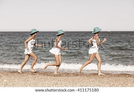Woman running on the beach. Multiple exposure shot. - stock photo