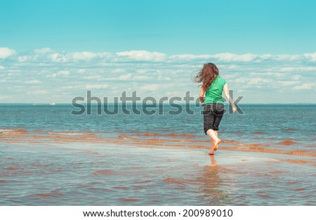 Woman running on the water
