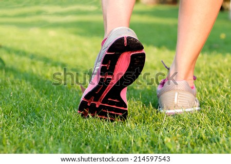 woman running step on grass