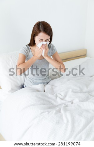 Woman runny nose on the bed