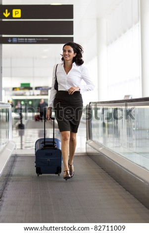 Woman runs at the airport - stock photo