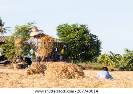 Woman rural farmer with haystack prepare for agriculture with children - stock photo